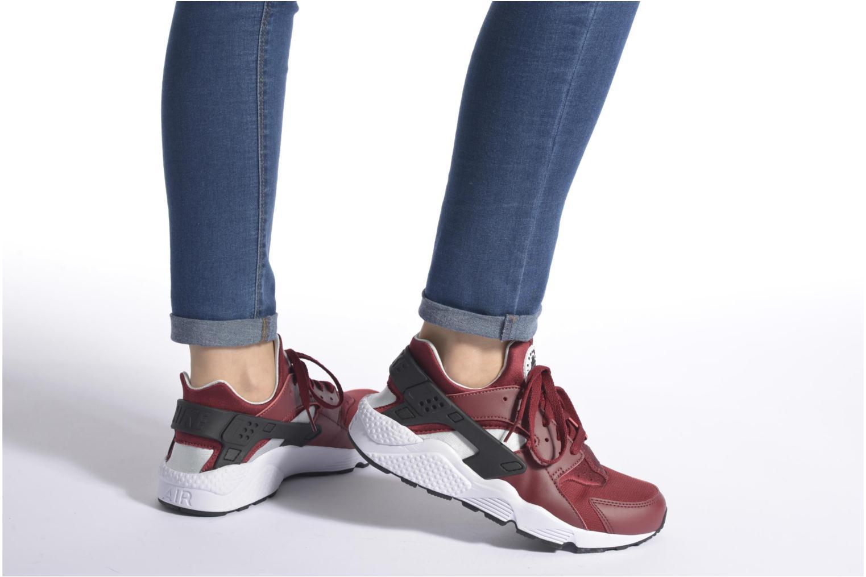 Sneaker Nike Nike Air Huarache schwarz ansicht von unten / tasche getragen