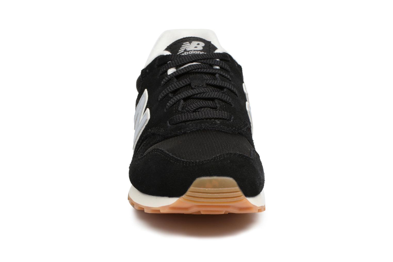 Baskets New Balance ML373 Noir vue portées chaussures
