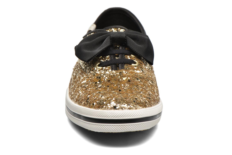 Deportivas Keds Ch Laceless Kate Spade Tuxedo Bow Glitter Oro y bronce vista del modelo