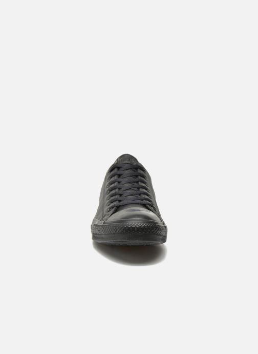 Sneakers Converse Chuck Taylor All Star Monochrome Leather Ox M Nero modello indossato