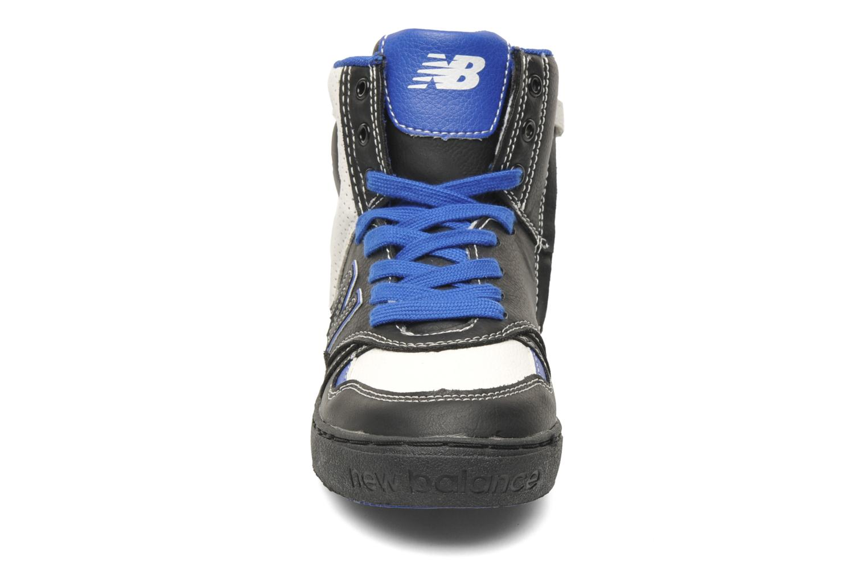 Baskets New Balance KT1052 Noir vue portées chaussures