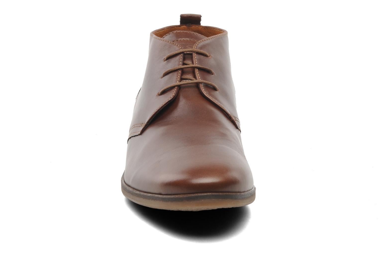Boots Kost Merle 67 Brun bild av skorna på