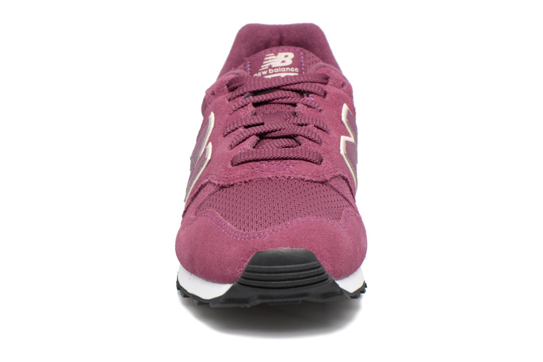 Baskets New Balance WL373 Violet vue portées chaussures