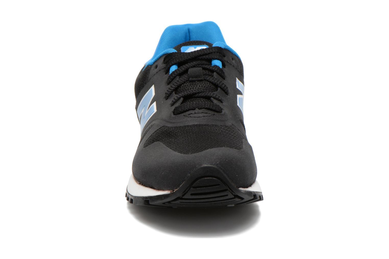 Baskets New Balance ML565 D W Noir vue portées chaussures