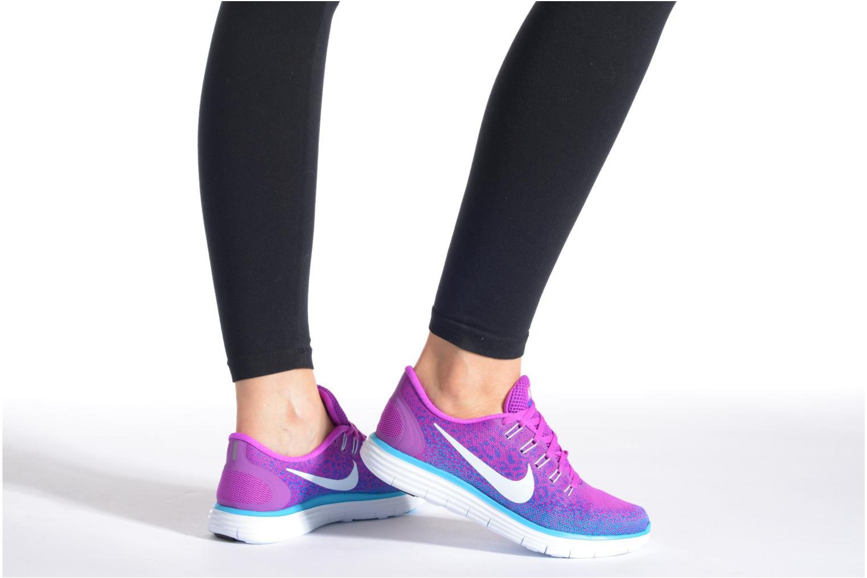 Chaussures de sport Nike Wmns Nike Free Rn Distance Orange vue bas / vue portée sac