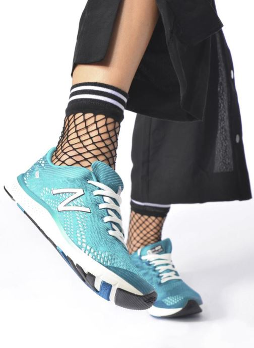 Sport shoes New Balance WXAGL Blue view from underneath / model view