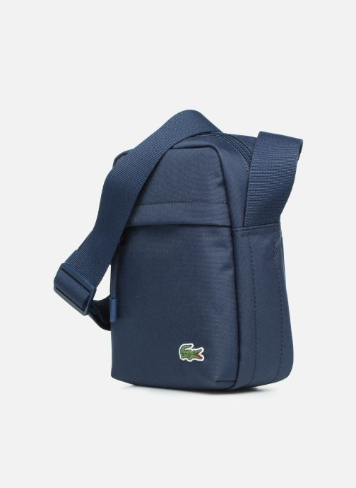 Herrentaschen Lacoste Neocroc Vertical Camera Bag blau schuhe getragen