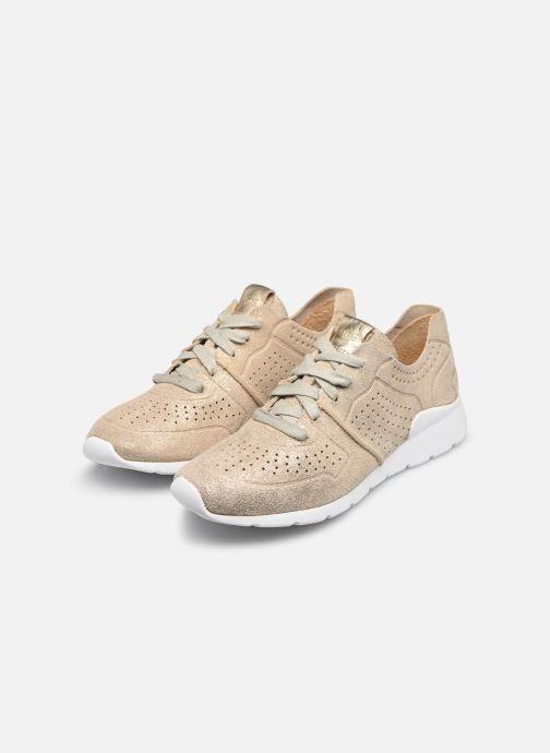 Sneaker UGG Tye Stardust gold/bronze ansicht von unten / tasche getragen
