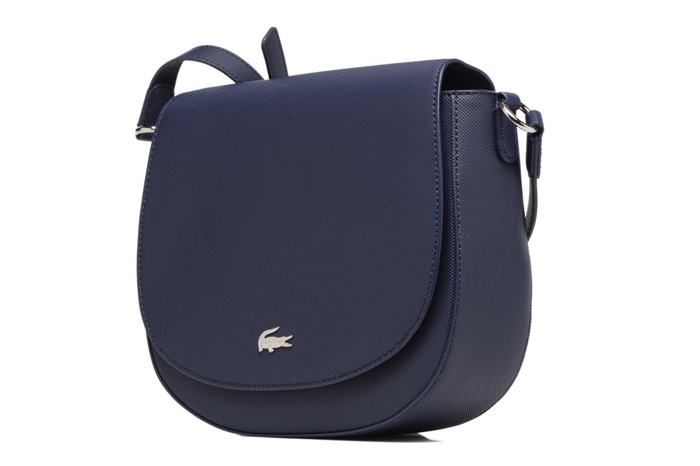 Sacs à main Lacoste ROUND CROSSOVER BAG Bleu vue portées chaussures