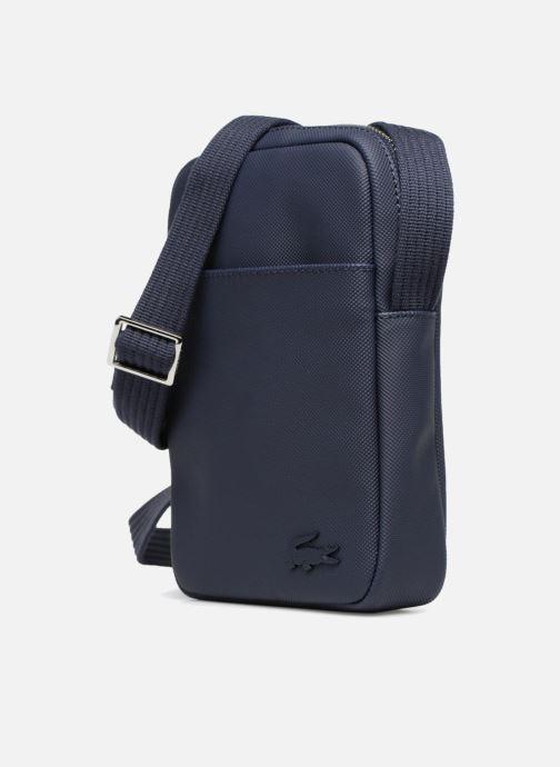 Sacs homme Lacoste Men'S Classic Slim Vertical Camera Bag Bleu vue portées chaussures