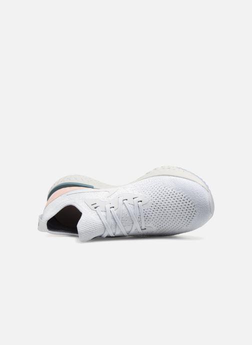 Sportskor Nike Wmns Nike Epic React Flyknit Vit bild från vänster sidan