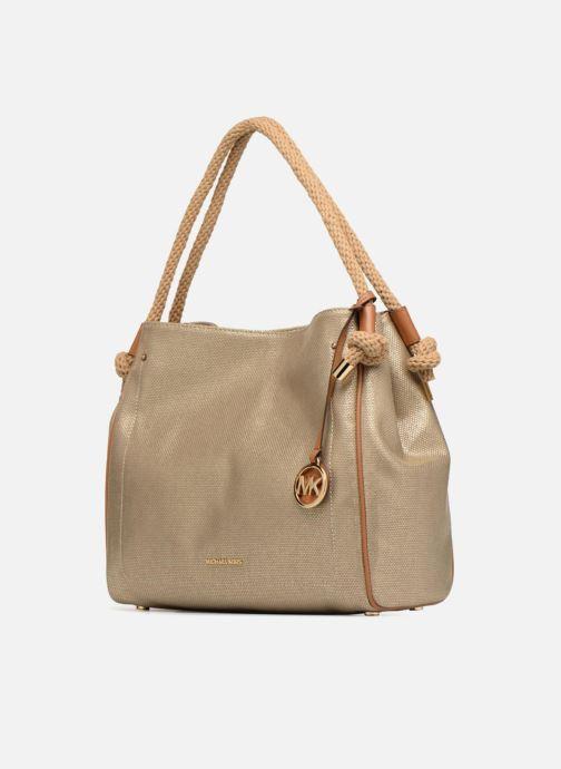 Sacs à main Michael Michael Kors Isla LG Grab Bag Or et bronze vue portées chaussures