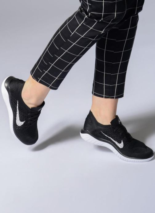 4792ba437f5f Sport shoes Nike Wmns Nike Free Rn Flyknit 2018 Black view from underneath    model view