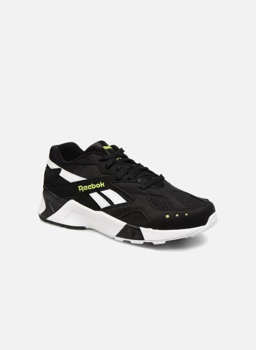Paire de chaussure Reebok noir et dorée