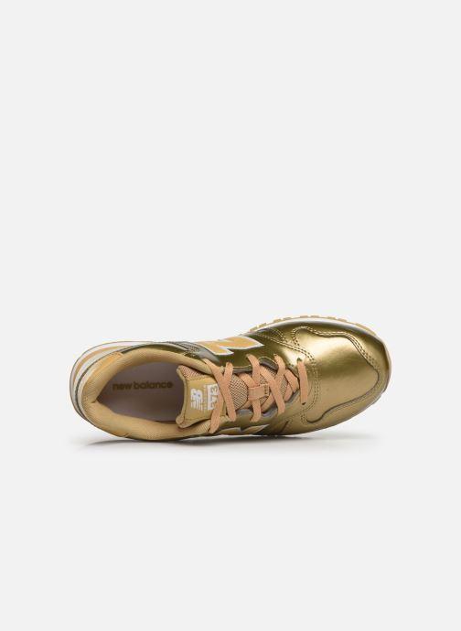 Sneaker New Balance YC373 gold/bronze ansicht von links