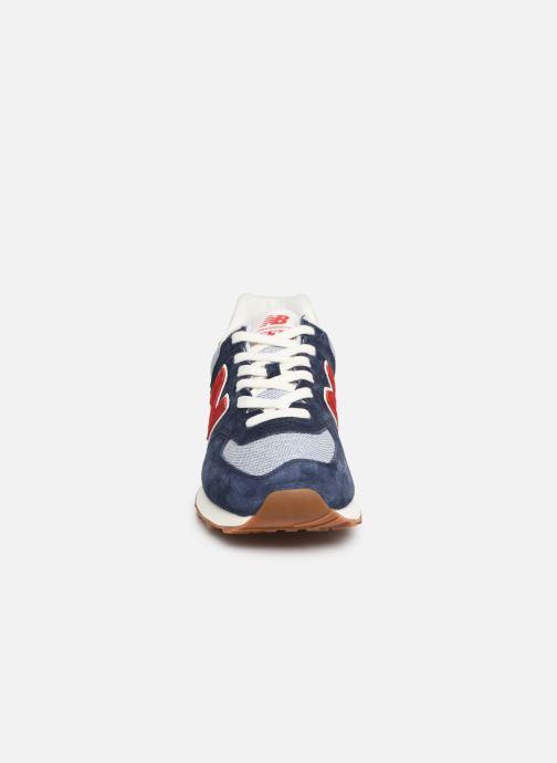 Baskets New Balance 574 Bleu vue portées chaussures
