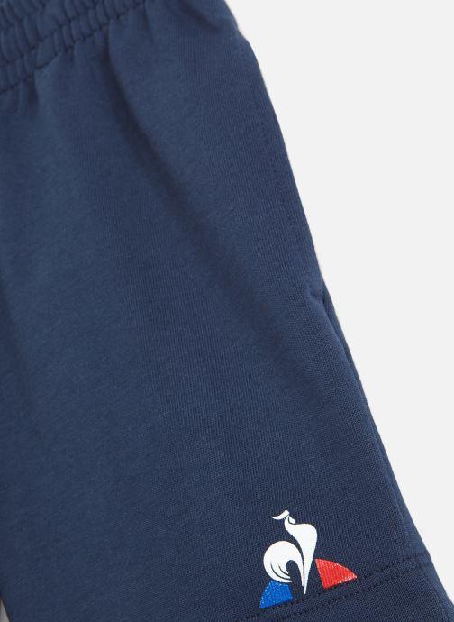 Vêtements Le Coq Sportif ESS Short Regular N°2 JUNIOR Bleu vue portées chaussures