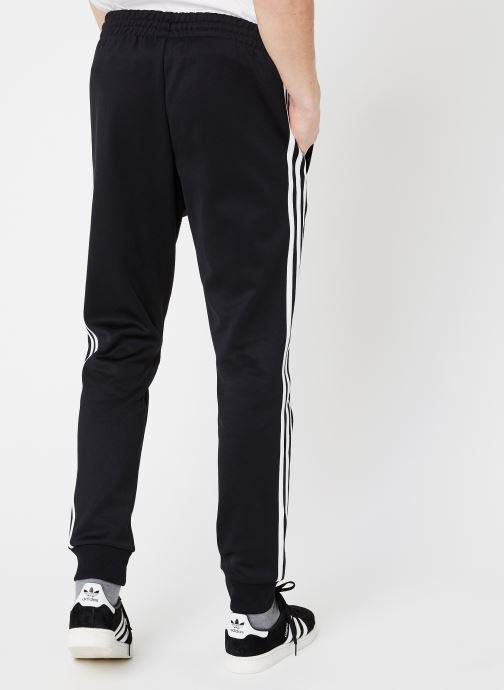 Vêtements adidas originals Sst Track Pants Noir vue portées chaussures