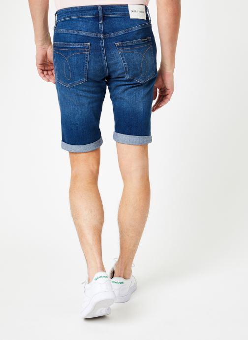 Vêtements Calvin Klein Jeans SLIM SHORT Bleu vue portées chaussures