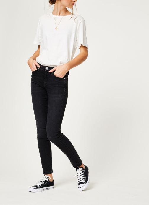 Vêtements Calvin Klein Jeans CKJ 011 Mid Rise Skinny Noir vue bas / vue portée sac