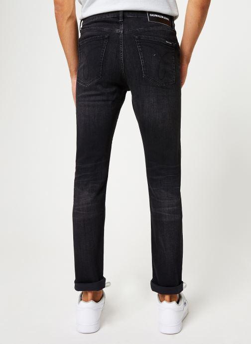 Vêtements Calvin Klein Jeans CKJ 058 Slim Taper Noir vue portées chaussures