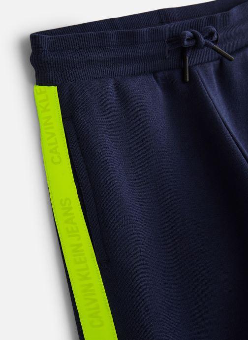 Vêtements Calvin Klein Neon Tape Sweatpants Bleu vue portées chaussures