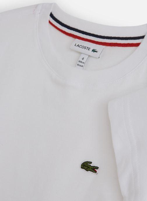 Vêtements Lacoste Tee-Shirt enfant Blanc vue portées chaussures