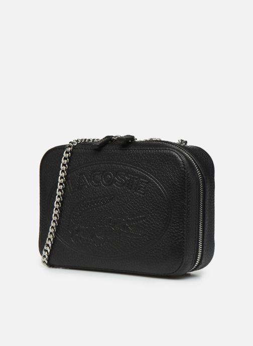 Sacs à main Lacoste CROCO CREW CUIR  CROSSOVER BAG Noir vue portées chaussures