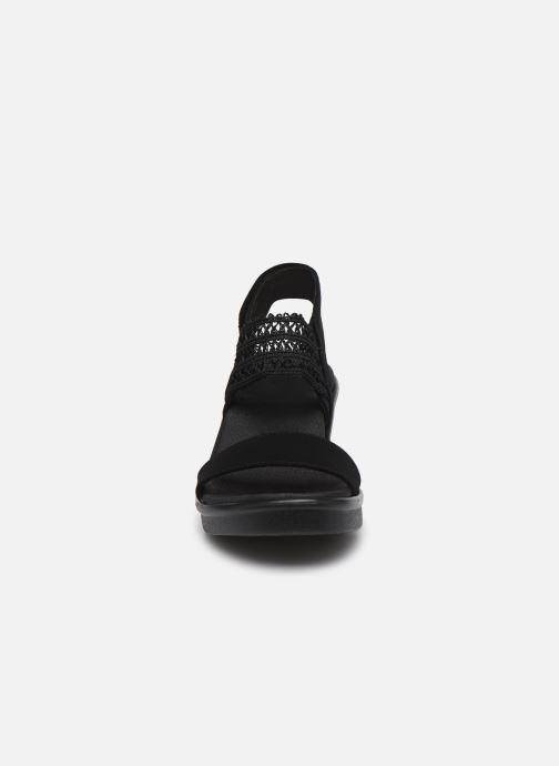 Sandali e scarpe aperte Skechers RUMBLE ON TAKEOVER Nero modello indossato