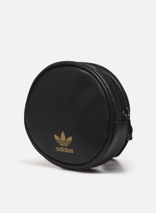 Pelletteria adidas originals Waistbag Round Nero modello indossato