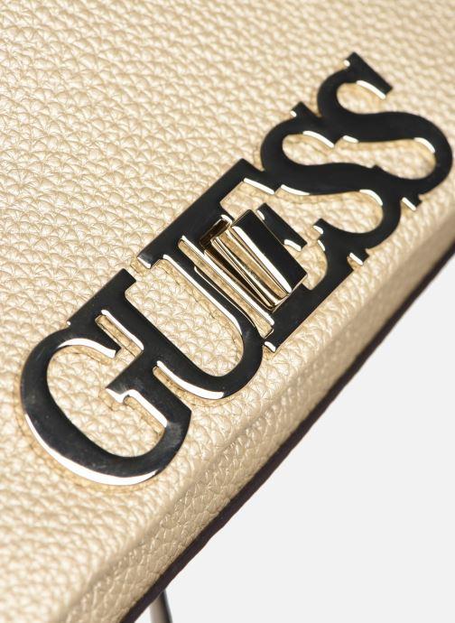 Bolsos de mano Guess UPTOWN CHIC  MINI XBODY FLAP Oro y bronce vista lateral izquierda