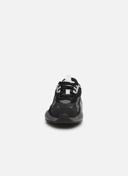 Sneakers Puma Rs-X3 Cube Nero modello indossato