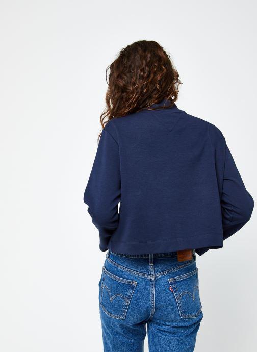 Vêtements Tommy Jeans TJW Solid Hybrid Longsleeve Bleu vue portées chaussures