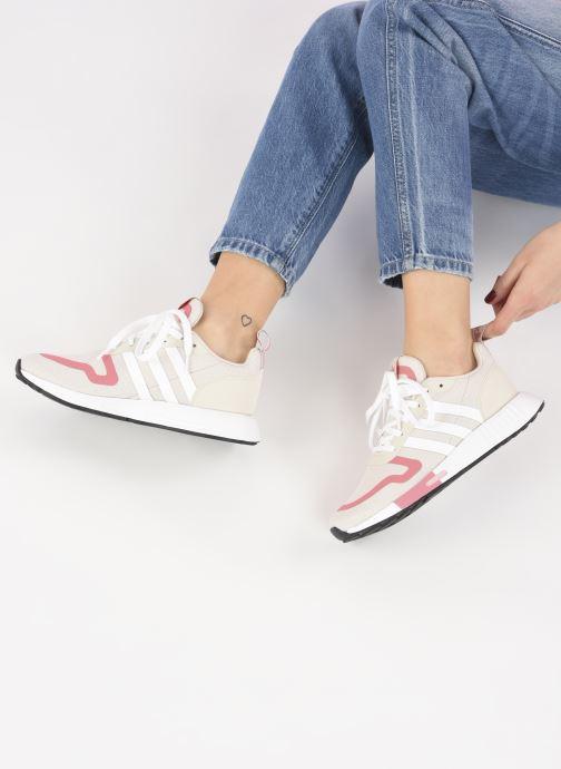 Sneaker adidas originals Smooth Runner W rosa ansicht von unten / tasche getragen